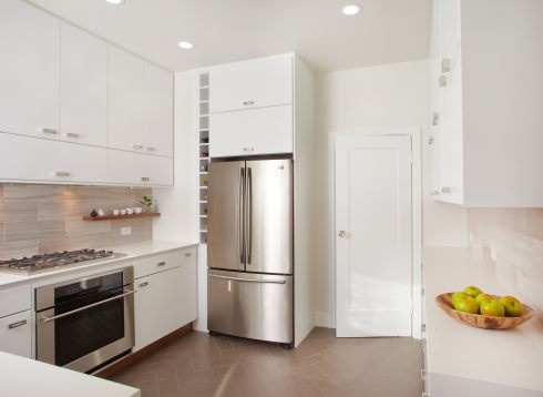 Modern white kitchen herringbone floor tile
