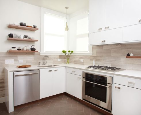 Modern white kitchen travertine tile